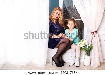 Mothers day holiday concept. mother and little daughter with flowers - stock photo