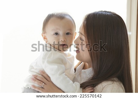 Mothers looking at her baby - stock photo