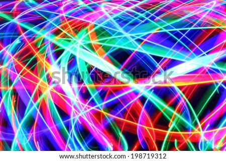 Motion a motley spots as abstract of-focus background. - stock photo