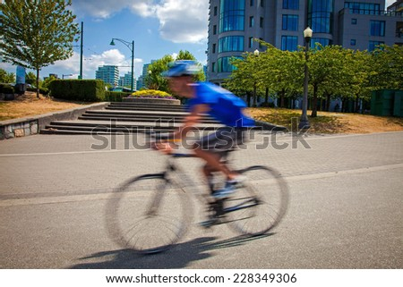 Motion blur a bike rider on the street - stock photo