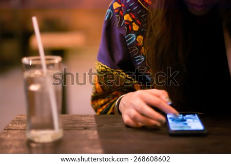 motion blur.art and vintage style.a woman in the bar - stock photo