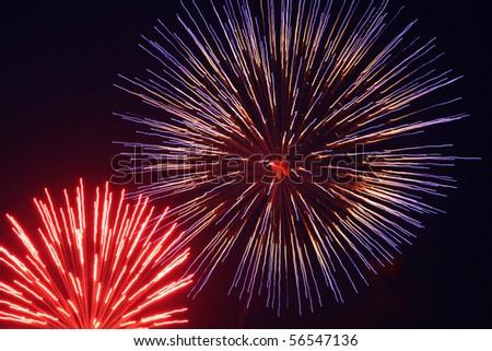 Motion Blur Fireworks in Night Sky - stock photo