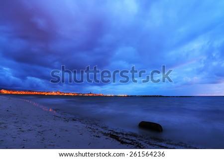 motion blur in Alghero shoreline on a cloudy night, Sardinia - stock photo