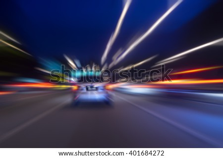motion blur in city street at night - stock photo