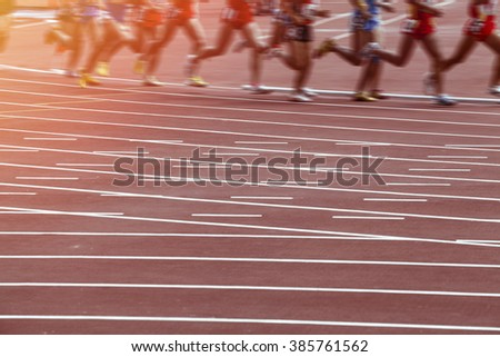 Motion blur man track and field race - stock photo