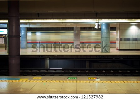 Motion blur of high speed train in subway, Narita airport station, Japan - stock photo