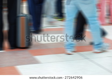 motion Blur of people traveling - stock photo