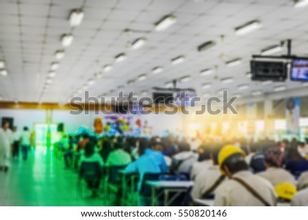 Motion blur of view of seminar with audience in a seminar room , a lot of people view in seminar room blurred background
