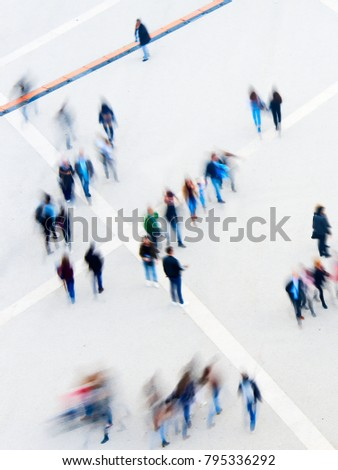 Motion blur of walking people. View from above