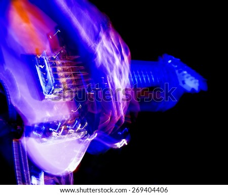 motion blur on an electric guitarist - stock photo