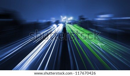 Motion blur on highway - stock photo