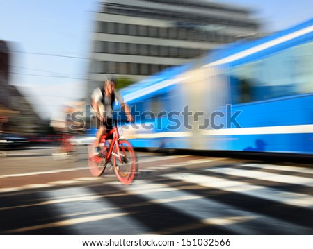 Motion blurred bike in dito traffic - stock photo