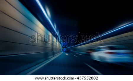 motion blurred car in tunnel