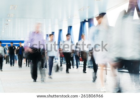 Motion blurred commuters in Hong Kong. - stock photo
