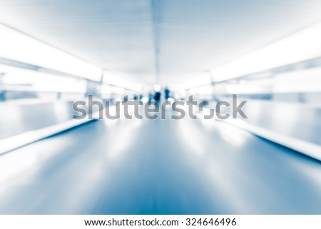 Motion blurred crowded people background with blue tone tuned - stock photo