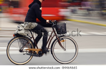 Motion blurred female biker - stock photo