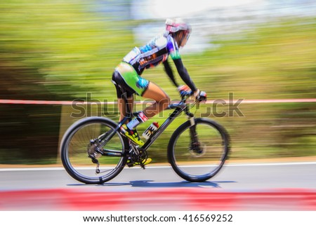 Motion blurred of the cyclist riding a bicycle in mountain bike