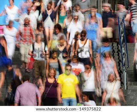Motion blurred pedestrians in stairs - stock photo