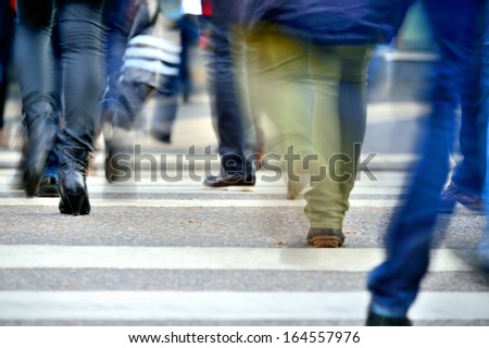 Motion blurred pedestrians on zebra crossing