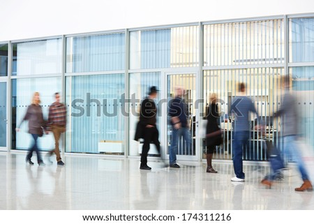 motion blurred people in office building