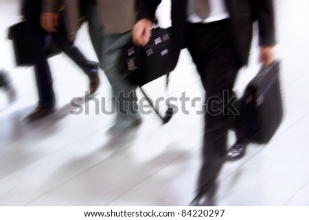Motion Blurred People.People walking in a corridor, motion blur, toned image. - stock photo