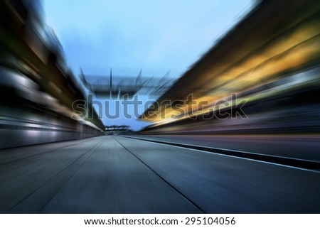 Motion blurred racetrack - stock photo