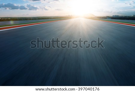 Motion blurred racetrack,morning - stock photo