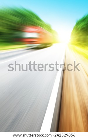 Motion blurred red truck on highway. - stock photo
