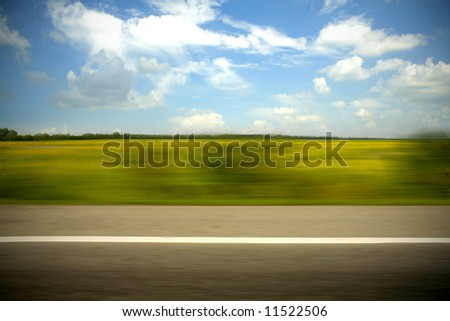 Motion blurred road - stock photo