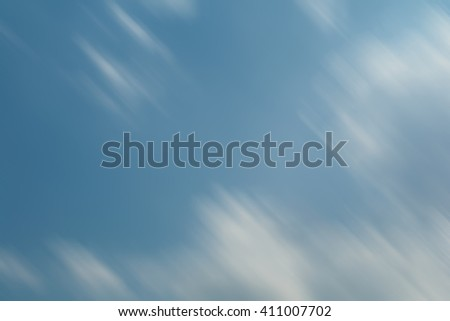 Motion blurred sky for background - stock photo