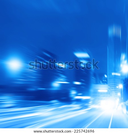 Motion blurred toned image of traffic in the city at night. - stock photo