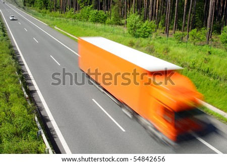 Motion blurred truck on highway. Trade metaphor. - stock photo