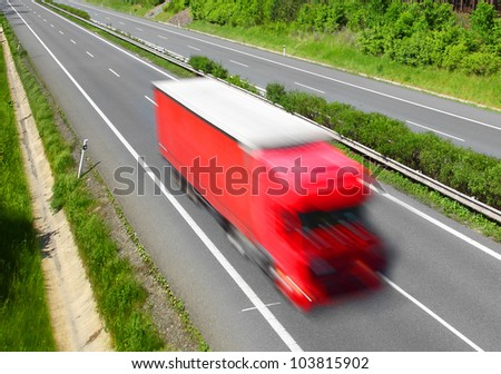 Motion blurred trucks on highway. Transportation industry concept. - stock photo