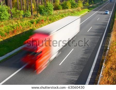 Motion blurred trucks on highway. Transportation industry metaphor - stock photo