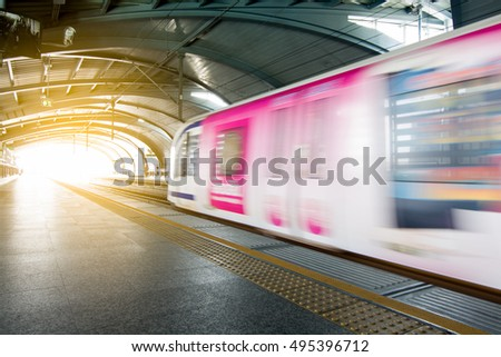 Motion burred sky train on station