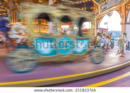 motion of Carousel Horse for children in amusement park. - stock photo