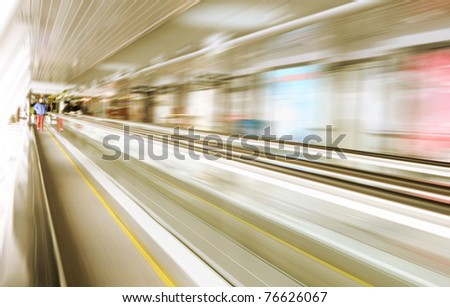 Motion of escalator in glass corridor