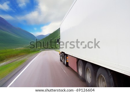 Motion of semi-truck on the mountain road - stock photo