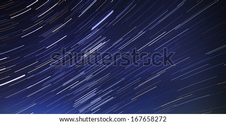 Motion of the stars in the night sky - stock photo