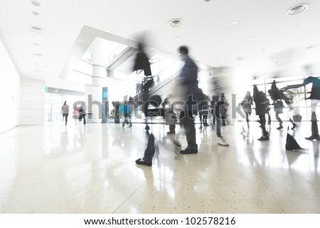 motion people in modern building - stock photo