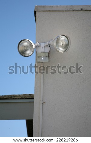 motion sensing lights attached to a house - stock photo