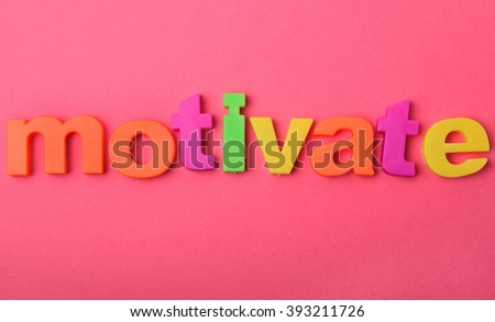 Motivate word on pink background - stock photo