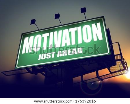 Motivation - Green Billboard on the Rising Sun Background. - stock photo