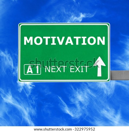 MOTIVATION road sign against clear blue sky - stock photo