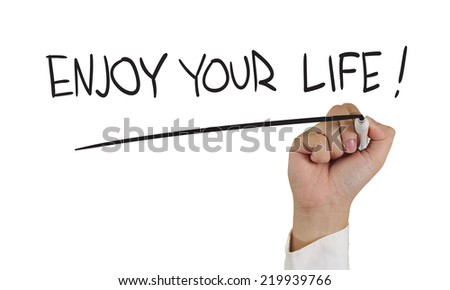 Motivational concept image of a hand holding marker and write enjoy your life isolated on white