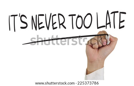 Motivational concept image of a hand holding marker and write Its never too late isolated on white - stock photo