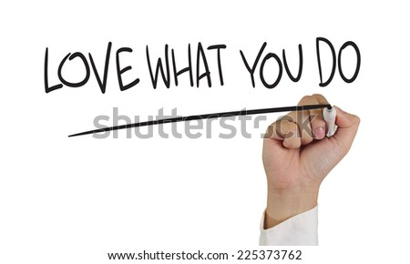 Motivational concept image of a hand holding marker and write Love what you do isolated on white - stock photo