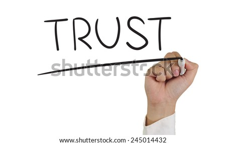 Motivational concept image of a hand holding marker and write Trust isolated on white - stock photo