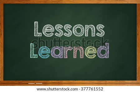 """Motivational quote """"Lessons Learned"""" written on chalkboard - stock photo"""