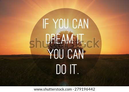 Motivational quote to make dreams came true on magical sunset with tree background - stock photo